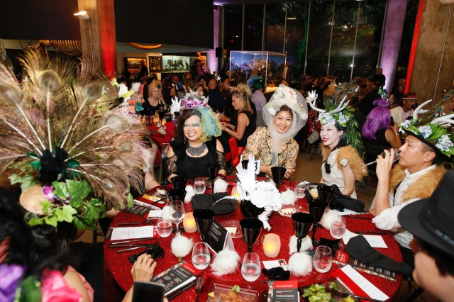 guests at dinner table special event hair ball tar pits
