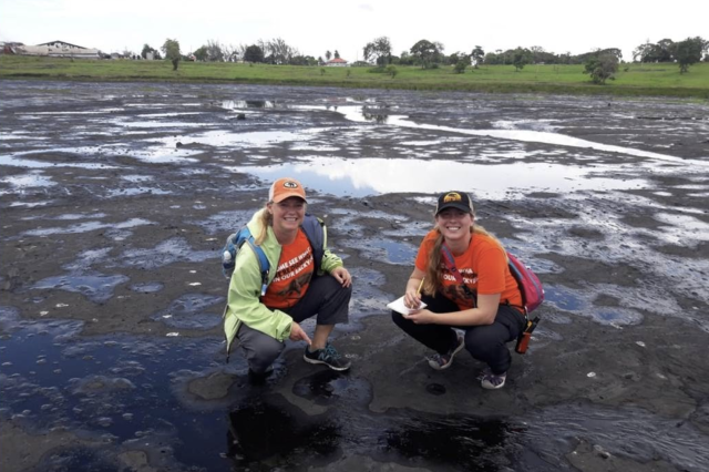 Two students on \site at a tar pit in Trinidad