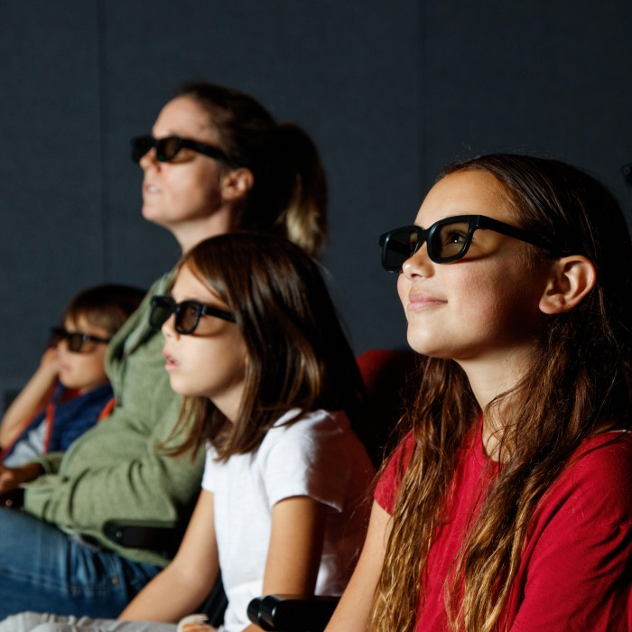 audience with 3D glasses in 3D theater