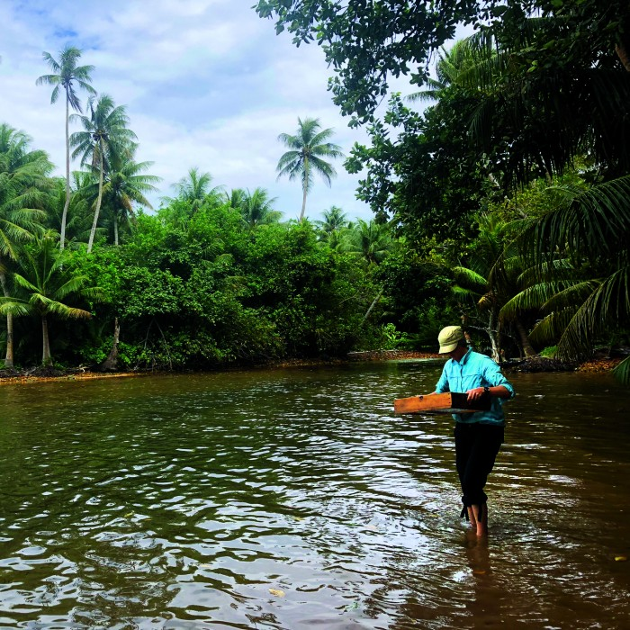 Amy Gusick doing field research in Micronesia