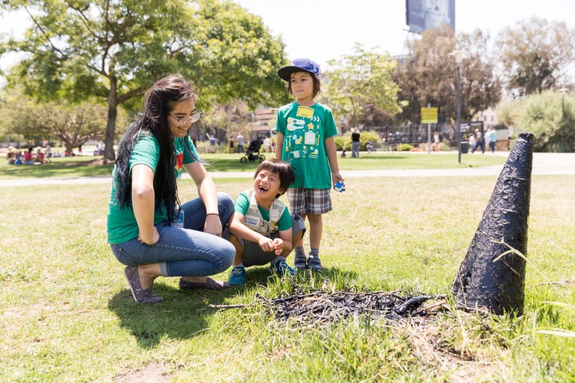 Rochelle Hoffman and two summer camp attendees laughing over a tar pit