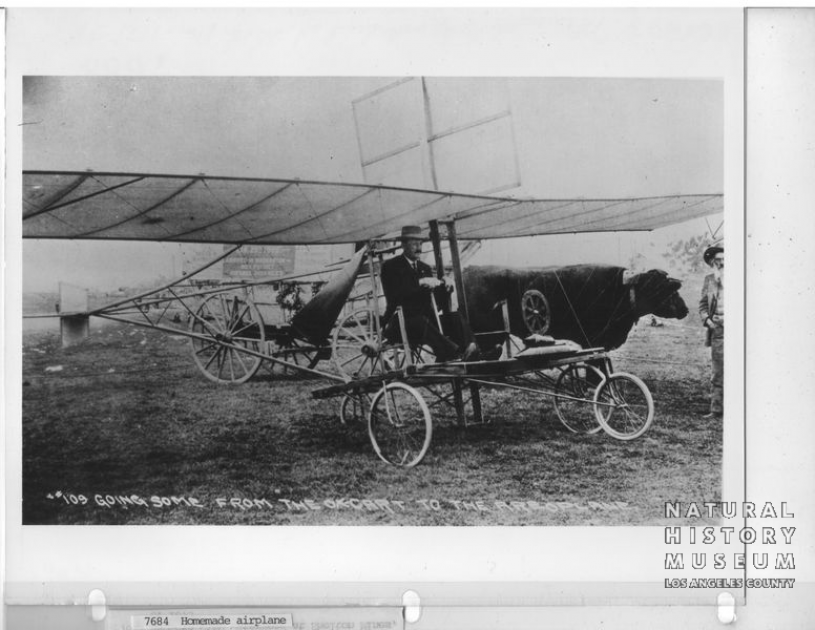 Early Airplane and Ox Cart