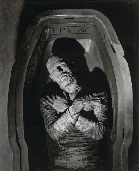 Still image from horror film The Mummy. The Mummy lies in a sarcophagus with arms crossed.